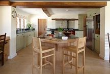 Period Farmhouse Kitchen / An elegant farmhouse kitchen for an accomplished chef that flows beautifully in to the other rooms in this 17th Century home. The beautifully crafted circular island cleverly hides storage for knives and the vegetable bin under a large chopping board; a sunken wine cellar provides a wonderful and interesting feature; and a practical laundry chute in the adjoining room makes this space individual and incredibly functional.