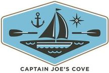 """Captain Joe's Cove / If we're not on an """"open road"""" we might be on a beach by the sea or near the ocean."""