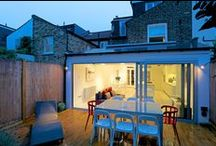 Contemporary wide pitched-to-hip roof kitchen extension