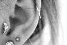 tattoos & piercings / always searching for inspiration, i don't have any tattoo's (i'd love to have one, but i cannot decide..) but i do have three piercings in my ear (2 forward helix, one helix) and a belly button piercing.