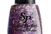 """'Top of the Class' - 70's / Salon Perfect's new """"Top of the Class"""" promotion gives a nail art history lesson on the 70's. Super glam, the top trend of the 70's revolved around the glitter ball of decadent disco. Never subtle, the look is bright and vibrant, distilled in a few simple words: flash, fun and glitter. Available now at select Walmart stores nationwide."""