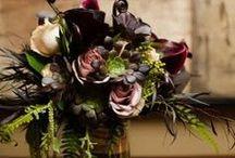 Arrangements in deep colors / flower arrangements in deep colors