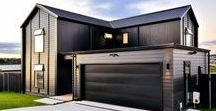 Dark and Dreamy... / Black clad Gable roofed home, featuring natural accents throughout