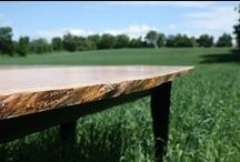 Custom Tables / Stinson Studios produces custom made tables of all sizes using reclaimed or selectively harvested woods.  Materials are selected for rare and unique characteristics like; spaulting, burling, maple syrup spile holes.  Some materials are even aged for up to 2 years to enhance color and characteristics.  Each table is made by hand for an individual customer.