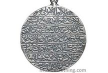 """Ayatul-Kursi Pendants / These are amazingly beautiful sterling silver Islamic pendants  inscribed with Ayatul-kursi. You may like our Zamzam water  vial pendants or the plate designs. They bear the well-known  """"Ayatul-Kursi"""" (Verse of the Throne) inscription. The above Ayatul-Kursi talisman is encased in a durable hard  glass sterling silver core and Zamzam water is legible to the  naked eye. Limited quantities available!"""