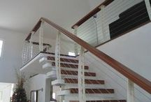 Puerto Rico Stairs / White Interior Cable railing on Cantilever Stairs. By: Keuka Studios