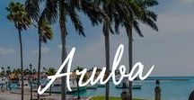 "Aruba / There's a reason Aruba is called ""One Happy Island."" Its white-sand beaches, cooling trade winds and warm, friendly people are just a few reasons why so many people return to Aruba year after year."