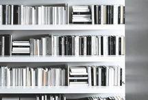 books on shelves; feet on floor
