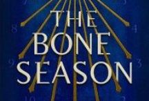 The Bone Season / The Bone Season by Samantha Shannon is one of my absolute favorite series at the moment. It's an urban fantasy dystopia with paranormal elements with fantastic writing, characters, world building, and plot.