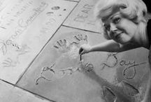 The Print Ceremony / Stars of yesteryear placing their handprints, footprints, faces (John Barrymore) and legs (Betty Grable) into cement at Grauman's Chinese Theatre.