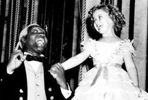 Shirley & Bill / Shirley Temple and Bill 'Bojangles' Robinson made movie history together by becoming the first interracial dancing team to hold hands on screen. They also became great pals in real life.  I think they're just great!