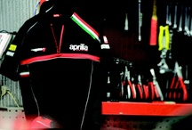 Aprilia Racing 2012 Official Teamwear / A collection inspired by sports, active lifestyles and the design of the brand's inimitable bikes. A world of passion expressed in garments with clean, sporty lines.Technical garments with details maximising comfort,visibility and protection. Casual garments enhanced with carbon-look prints and reflecting piping for a distinctly modern, sporty look. / by Aprilia Official
