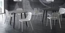 Iisoro & Isidora / This seating collection is composed of single-piece chairs, with and without arms, as well as a stool version. It is also available with upholstered seats and seatbacks. The Isidoro family has a strong recognition and formal identity, mainly due to the functional stylistic details of the back legs. Especially for the stool, they become a practical hook for bags, jackets, caps and other items. Both the chairs and the stools are also