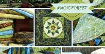 """Magic Forest / This is such a marvelous design. It's the remake of Pretty Purple in a complete different color scheme Jacqueline used to work with. Jacqueline calls them """"muddy"""", but they're just gorgeous. The blues in this design lightens up the quilt, and the faded yellows are so wonderful and make this design a stunning quilt."""
