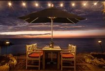 NI LED Parasol / Combining a parasol and garden torch, NI stands smart from morning to night, next to sun loungers or along the riverside. The proprietary finger-sensing one-touch dimmer allows easy brightness control of the 3-channel lighting system. Everything can be controlled separately at ease.