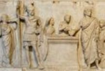 So-called altar of Domitius Ahenobarbus / This relief was excavated in the Campus Martius. It may belong to the base of a statuary group from a temple. There is dispute about the temple they came from, their date of commissioning and who commissioned them. To the left of the altar is a figure suggested to be of Mars to whom the Lustrum is dedicated. The figure wears a cingulum which indicates an officer instead of a god. This board will look at other examples of cingulum use to see whether the wearers are gods or soldiers.