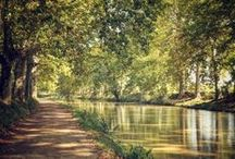 The Canal du Midi, South of France / The 330-Year-Old Canal du Midi skirts the sun drenched shore of the Mediterranean before meandering inland past ancient villages and Roman fortifications towards the famed wine region of Bordeaux.