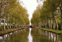 """Gascony, Southwest France - Travel Inspiration / The """"Canal des Deux Mers"""", comprising of the Canal de Garonne and the Canal du Midi, links the Atlantic to the Mediterranean, passing through the region of L'Occitanie – a veritable palette of colours and scents created by orchards and vineyards."""