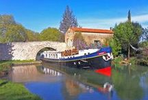 Hotel Barge Anjodi / The 8 passenger Anjodi is of classic Dutch design, specifically rebuilt to navigate the 330-year-old Canal du Midi. She has been completely refurbished in the tasteful tradition of African hardwoods, hand-crafted panelling and shining brass, creating a comfortable and charming ambience reminiscent of a classic yacht.