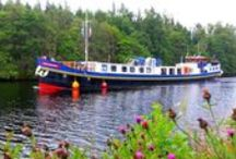 Hotel Barge Scottish Highlander / The 8 passenger Scottish Highlander has the atmosphere of a Scottish Country House with subtle use of tartan furnishings and landscape paintings. At 117 feet she is spacious and has every comfort needed for year round cruising