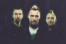 Thousand Foot Krutch / Thousand Foot Krutch is a Canadian Christian rock band. Members: Trevor McNevan - vocals, electric guitar, Joel Bruyere - bass guitar, backing vocals, Steve Augustine - drums. Side project of TFK is Canadian pop-punk band FM Static - Trevor McNevan and Steve Augustine.
