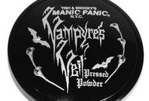 """Vampyre's Veil Pressed Powders / Our Virgin Powder is great for Goth enthusiasts who prefer a """"whiter shade of pale"""". The three Vampyre's Veil colors come in more natural tones. Inside, there are two levels to the compact: one part has a mirror and the product, and the other compartment has a powder puff applicator. The packaging is hand-decorated with rhinestone accents, and comes in an organza bag."""