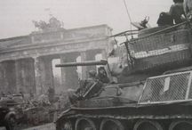 T-34/85 with additional protection in Berlin 1945. / Russian T-34/85 tank with additional protection with bedsprings and sections of fence against Holloway charges like the Panzerfaust.