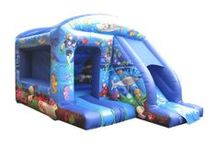 """Slide Combo Bouncy Castles / """"Combo unit"""" is the generic term normally used to describe bouncy castles which include a slide and obstacles. Slides can come from the side of an A Frame or from the front of a box bouncy castle or there can even be a slide inside a bouncy castle which is great for keeping the children contained.  / by Airquee Inflatables Limited"""