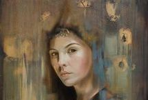 Elvira Amrhein (1957-) / Born in Germany, she lives and works in France. Elvira's work is deeply spiritual, intriguing, and overwhelming. For a moment the divine becomes alive, imbuing the artist's creations with the power to transform viewers into initiates. With a fluttering of wings, faces and bodies - like gold and marble spectres - take shape: melancholic and sensual, indeed, troubling. Like apparitions, they flood the canvas with mysticism, reflecting back towards the soul of the observer.