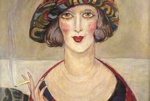 Gerda Wegener (1886-1940) / Gerda Marie Fredrikke Wegener, nee Gottlieb, was a Danish illustrator and painter, one of the most prominent figures of the lesbian rights movements. She was married to Lili Elbe, one of the first-ever documented recipients of sex reassignment surgery. Her artwork largely contains images of fashionable women in the style of art mnouveau and later art deco.