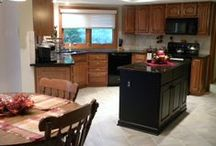 Pickerington Before and After Kitchen Remodel / This kitchen's peninsula was removed and replaced with an kitchen island with granite counter tops.We removed built-in light fixtures and replaced with can lights. We put in tile flooring, crown molding and a double bowl stainless steel sink.