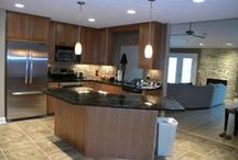 Columbus Transitional Kitchen / These cherry cabinets, black granite countertops, can lights, mosaic backsplash,and tile floors and a modern look to this kitchen.