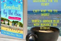 Summer Sundaes: The Boardwalk by the Sea Bk1 / Wipe your flip flops it's going to be a bumpy ride!  A four-book series about the inhabitants of a village known locally as the Boardwalk by the Sea.   Four friends, each with their home and business on the boardwalk, are coping with individual problems and a local mystery. For a small community there's an awful lot going on.