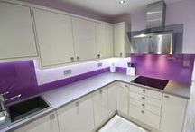 Modern Kitchen, With Striking Purple Splash-back / Gloss door in 'Latte', laminate work top with a bold striped edge. Striking purple glass splash back & up-stands. Designed, Supplied and Installed by KITCHENCRAFT Witham.