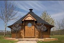 Sleeps12 BBQ Lodges / Just imagine, it's a cold, wet and blustery evening but everyone can enjoy a barbecue! You're warm and cosy, sitting around the fire inside your BBQ Lodge.