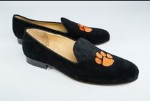 Clemson University / JP Crickets is the go-to men's and women's shoe that combines an Italian-made loafer with the comfort of a classic velvet slipper. The relaxed style shoe boasts an embroidered college logo shoe on suede, velvet, or linen with an all leather sole. Tassel loafers, monogrammed logos, and custom designed shoes also available. Italian-made loafers embroidered with college logos or monograms on suede, linen, or velvet. Let's Go Tigers! @clemsonuniversity #ClemsonTigers / by JP Crickets University and Collection Loafers