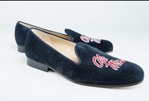 Ole Miss - University of Mississippi / The Ole Miss Shoes logo shoes for men and women. JP Crickets is the go-to men's and women's shoe that combines an Italian-made loafer with the comfort of a classic velvet slipper. The relaxed style shoe boasts an embroidered college logo shoe on suede, velvet, or linen with an all leather sole. Tassel loafers, monogrammed logos, and custom designed shoes also available. Italian-made loafers embroidered with college logos or monograms on suede, linen, or velvet. @olemissrebels / by JP Crickets University and Collection Loafers