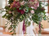 Tall Centerpieces / Tall centerpieces create an impact and drama when guests walk into a room.