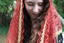 """Red and Pink Veils / Welcome to our """"Warm Tones"""" department!  Rosy red, pink, russet and burgundy jewel hued laces are woven into a wide variety of beautiful mantilla veils.  Some of the veils double as bulky scares and evening wraps.  All are for wear at Mass and before the Blessed Sacrament."""