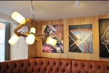 Nando's Restaurant Art / Nando's is significantly invested in South African art - housing a growing collection of over 7500 original pieces in its restaurants and offices across the globe. Their Global Art Initiative was started in 2001 and centres on a partnership with Yellowwoods Art, whereby original art is sourced for their restaurant and office spaces through a number of innovative programmes.