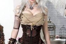 Steampunk Girls and Fashion / Beautiful Steampunk girls and the things they wear. Corsets, goggles, chain bracelets, dresses, and the occasional gun. / by Geek House Creations