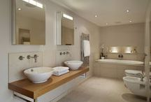 Case Study - Contemporary En-suite Bathroom / Set amongst spectacular views of the Dorset countryside the converted three storey barn required a change to the master en-suite bathroom to create a more characterful space. The clients wanted to completely renovate the existing bathroom as it felt cold and, due to the long narrow layout, like a bowling alley in appearance.