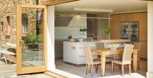 Inside-Outside bulthaup b3 Kitchen / Folding corner doors open this hobsons|choice bulthaup b3 kitchen space out into the beautiful property grounds. Natural oak and subtle, Flint and Gravel tones ensure the kitchen complements the decor and the gardens.
