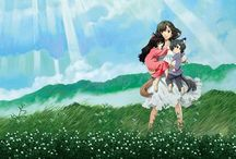 "Wolf Children / The story covers 13 years and begins with a 19-year-old college student named Hana who encounters and falls in ""fairy tale-like"" love with a ""wolf man."" After marrying the wolf man, Hana gives birth and raises two wolf children—an older sister named Yuki who was born on a snowy day, and a younger brother named Ame who was born on a rainy day."