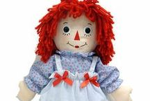 Raggedy Ann / Raggedy Ann is a fictional character created by American writer Johnny Gruelle (1880–1938) in a series of books he wrote and illustrated for young children. Raggedy Ann is a rag doll with red yarn for hair and has a triangle nose. The character was created in 1915 as a doll, and was introduced to the public in the 1918 book Raggedy Ann Stories. A doll was also marketed along with the book to great success. A sequel, Raggedy Andy Stories (1920) introduced the character of her brother Raggedy Andy