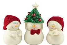 Snowpinions / Porcelain bisque ornaments with hand-knit hats, earmuffs and scarves. Each delivers funny and sweet heartfelt sentiments to family and friends. Designed by Snowbabies artist Kristi Jensen Pierro.