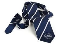 Custom School Neckties / Choose between Polyester, Silk, Satin, or Teflon for your custom ties. Feel free to request free samples from previous orders to compare fabric and quality of our products. While most neckties are woven, you can also have them printed. The standard regular custom tie is approximately 57 inches long and 3.75 inches wide. We also offer custom sizes and custom widths. Ties are also available in boys and extra long. Additional charges will apply for extra long ties.