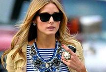 Olivia P. wearing statement necklaces