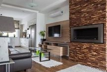 Our Project August 2014 / Our customer used Wallure Striped - Walnut - Narrow - Split - Varnished panels for this project. In the living room they decorated the wall around the built in fireplace. In the bathroom they decorated a small wall above the bath.