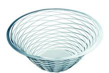 NET Metal bowl - Limited edition - 2004 / A cut in a flat metal plate creates a pattern that allows you to create a bowl when pressing the plate with your own hand. 2D turns into 3D by the hand of the user, making each object individual. A simple idea – that took an advanced mathematical formula to produce. Shipped as light, flat package.  Year Completed: 2004 Design: Monica Förster Design Studio